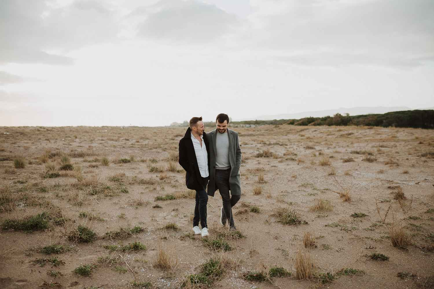 Gay couple engagement shoot in the beach of Barcelona